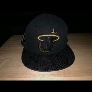 Black and gold Miami heat fitted cap